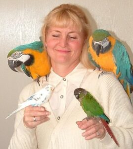 Leslie with four of her birds.
